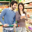 Couple shopping in a supermarket — Stock Photo #75999147
