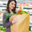 Woman holding shopping bag — Stock Photo #75999295