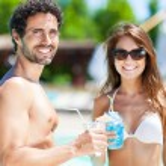 Couple enjoying drinks — Stock Photo #76739029