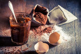 Taste of childhood, egg yolk with sugar and cocoa — Stock Photo