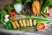 Fried spring rolls surrounded by ingredients — Stockfoto