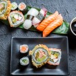 Sushi with soy sauce on black rock — Stock Photo #53486895