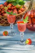 Homemade strawberry liqueur with mint — Stock Photo