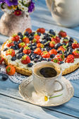 Coffee and fruit tarts served in the garden — Stock Photo