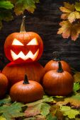 Halloween pumpkins on autumn leaves — Stock Photo