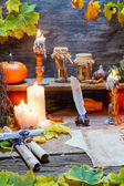 Scribe desk full of recipes and candles — Stock Photo