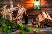 Homemade red wine in a wicker basket — Stock Photo