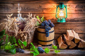 Grapes and red wine in a demijohn — Stock Photo