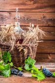 Demijohn full of red wine in the cellar — Stock Photo