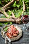 Closeup on freshly baked venison on a plate — Stock Photo