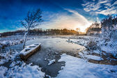 First snow in winter on the lake at sunrise — Stock Photo