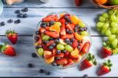 Preparing a healthy spring fruit salad — Stock Photo