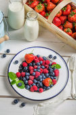 Fresh berry fruits with milk — Foto Stock