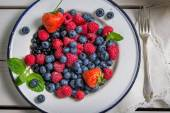 Fresh berry fruits with milk — Stock Photo