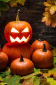 Pumpkins pile with autumn leaves — Foto de Stock