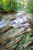 Slippery rocks in a mountain stream — Stock Photo