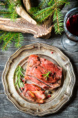 Piece of venison served with red wine — Stock Photo