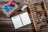 Old abacus, pen and books on mathematics classes — Stock Photo