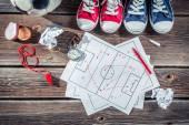 Soccer formation tactics on school desk — Stock Photo