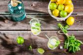 Closeup of lemon drink with ice in glass — Stock Photo