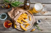 Fresh french fries served with beer — Stock Photo