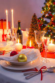 White and red decorations on the Christmas table — Stock Photo