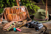 Bag, bullets and hat in a hunting lodge — Stock Photo