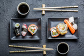 Sushi for two served on black stone — Stock Photo