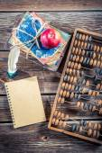 Old abacus and notes on math classes — Stock Photo