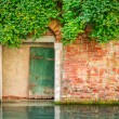 Ancient entrance in a house on a canal in Venice — Stock Photo #56430715