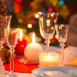 Candlelight, wafer and gifts on the Christmas table — Stock Photo #56498195