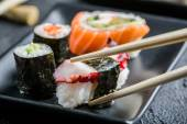Closeup of sushi eaten with chopsticks — Stock Photo