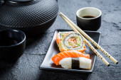 Sushi served with tea — Stock Photo