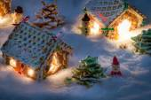 Small gingerbread houses in the snow — Stock Photo