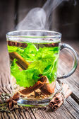 Warm tea with green leaves — Stock Photo