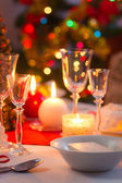 Candlelight, wafer and gifts on the Christmas table — Stock Photo