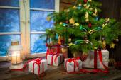 Warm cottage in winter Christmas evening — Stock Photo