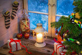 Warm cottage in a Christmas evening — Stock Photo
