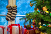 Christmas cottage full of gifts — Stock Photo
