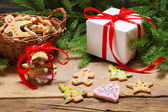 Preparing gingerbread cookies as a gift on old wooden table — Stock Photo
