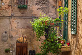 Beautiful balcony decorated with flowers in italy — Stock Photo