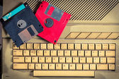 Vintage floppy disks and keyboard — Stock Photo
