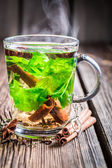 Hot tea with cinnamon and ginger — Stock Photo