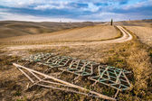Harrows on a brown field in Tuscany at autumn — Foto de Stock