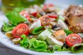 Closeup of cesar salad with vegetables — Stock Photo