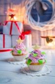 Two little cupcakes decorated for Christmas — Stock Photo