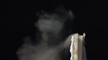 Candle blow off with smoke isolated on black background — Stock Video
