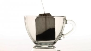 Brewing up hot tea with teabag isolated on white background — Stock Video