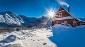 Warm accommodation in cold winter mountains — Stock Photo