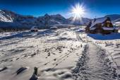 Winter mountain trail to a warm shelter — Stock Photo